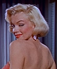 The blonde conjures of many images including ingenue, vamp, girl next door, glamor woman, bombshell, and ice goddess.   Marilyn Monroe is blondeness magnified.