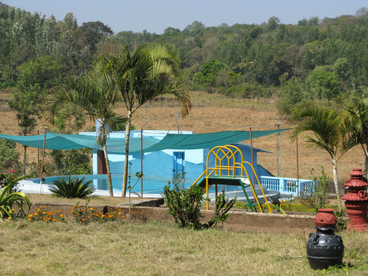 The swimming pool and the children's play area.