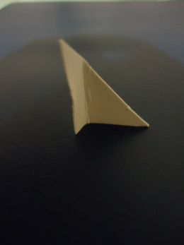 Just fold the triangle a little bit to create a flap and glue it to the back of the picture.