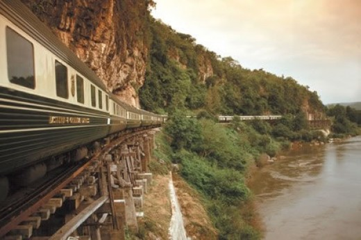 Eastern and Oriental Express offers scenic rail journeys in South East Asia crisscrossing luxh rainforests and picturesque landscapes