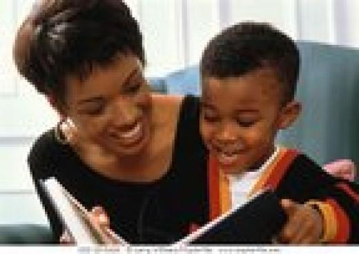 An attentive child read a book
