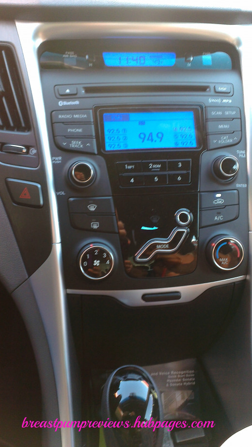 Clock, AM/FM, CD/MP3 Player, XM Radio Controls, A/C & Heater Controls, Rear Defogger, Hazard Lights and View of Storage