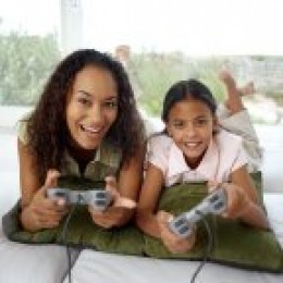An attentive child play a video game