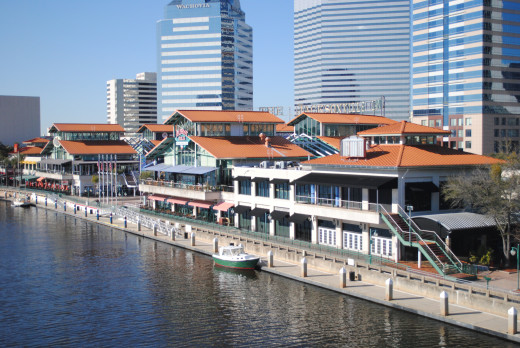 Jacksonville Landing, which overlooks the St John's River.  The shopping, dining, clubbing, and museum complex was built at a cost of $37.5 million by the Rouse Company and opened to the public in 1987.