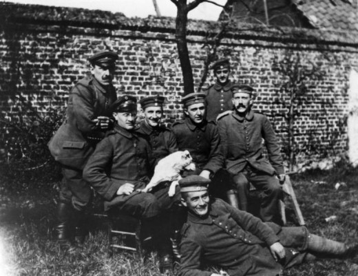 Hitler with members of his regiment during WW1. Hitler is seated on the far-right (no pun intended).
