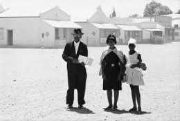 In apartheid South Africa, the Afrikaners, although they were technically a minority, were considered to be an ingroup with commensurate high status and massive opportunities.