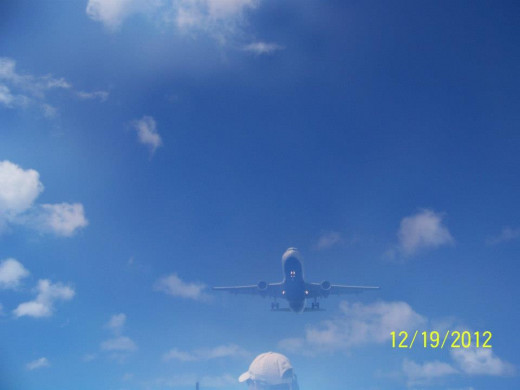A plane coming into Aruba. Image taken from a water taxi.
