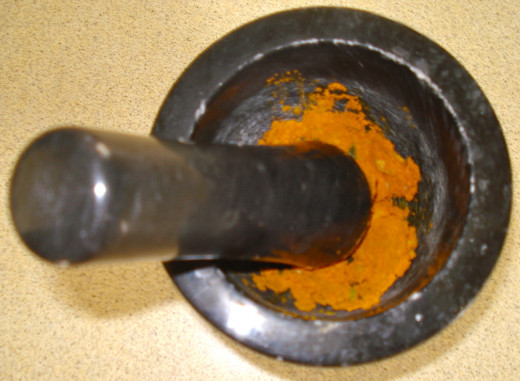 Make the turmeric and garlic into a paste