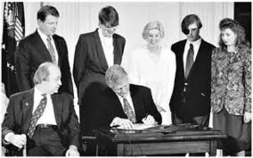 Clinton signs the Automatic Weapons Ban of 1994-2004.