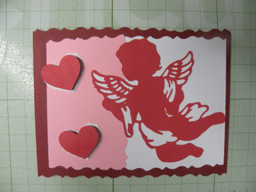 Hearts & Cupid adhered to front of the card