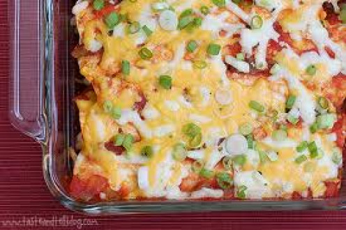 Enchiladas with green peppers and onions.