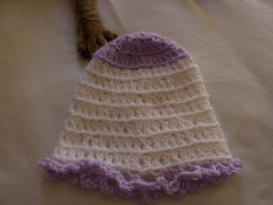 White basic beanie with lavender yarn used for first 3 rows and to create bottom edging