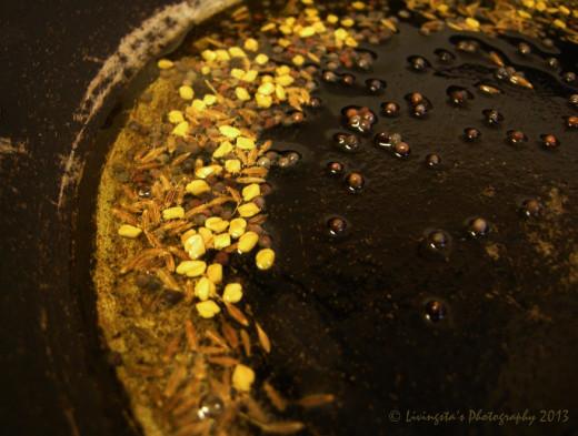 Seasoning oil with mustard seeds, fenugreek seeds and cumin seeds