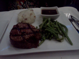 Steak with mashed potatoes and gravy and green beans for dinner