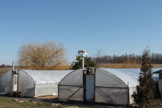 Amish Greenhouse equipped with air inflator to keep the plastic inflated.