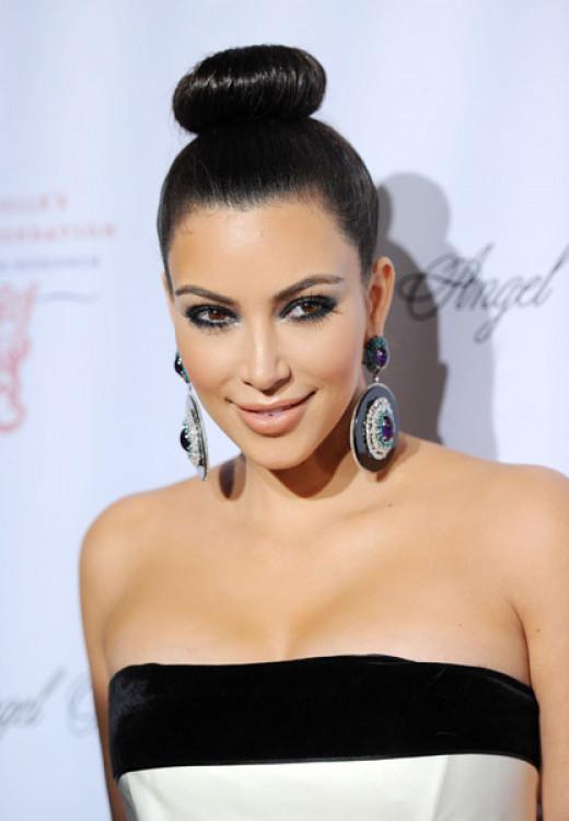Kim Kardashian rocking a high bun.