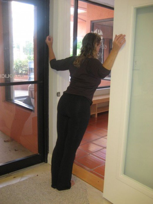 A stronger chest stretch using a door frame.