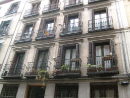 The flower boxes on this residential building on Calle Valverde are charming.