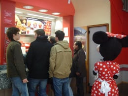 Yes, that is someone dressed up as Minnie Mouse waiting to place an order at KFC
