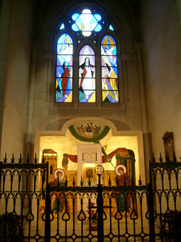 One of the chapels show a stained glass window with a biblical theme and artwork