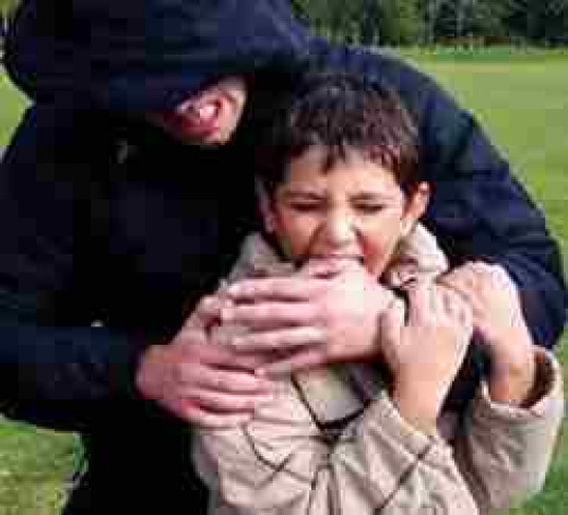 www.xtremekravmaga.com  Child learning self defence techniques. Simple as biting.