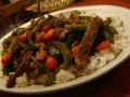 Beef can be budget friendly. Even the cheap cuts are delicious in Pepper Steak and Tomato over Rice