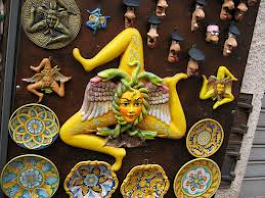 You'll see Sicily's triskelion for sale in various forms all up and down the main shopping area of Taormina.
