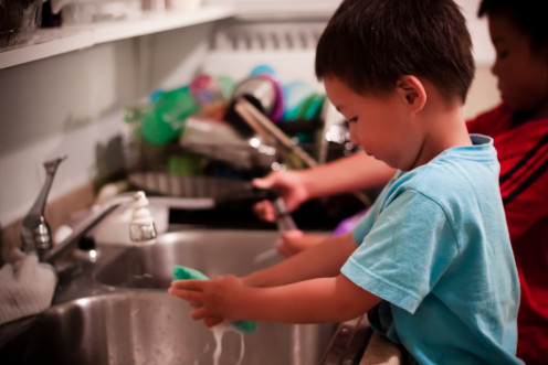 Washing dishes is a simple chore you can require of your child