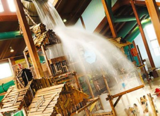 A thousand gallons of water pour over the indoor play set every eight minutes.
