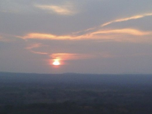 Love is....watching the sunset together.  This photo was taken from an overlook above Cañas Dulce, north of Liberia.