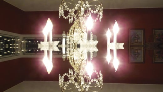 A hanging chandelier becomes a floating light display, a bit surreal but hey, a fun image.