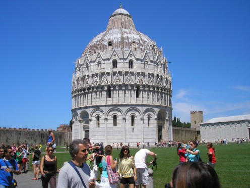 Battistero di San Giovanni is located in Piazza dei Miracoli near the Cathedral and Leaning Tower of Pisa in Italy. a popular tourist attraction.