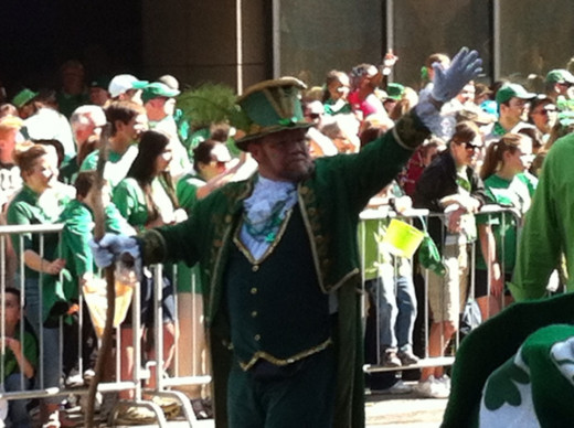 A leprechaun waves at the crowd during the 2012 Pittsburgh St. Patrick's Day Parade