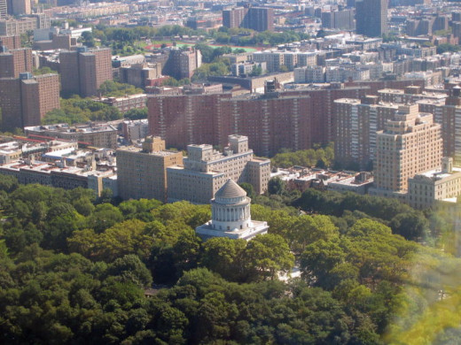 Grant's Tomb reaches above the treeline in New York City, Riverside Park. It is the largest mausoleum in North America.