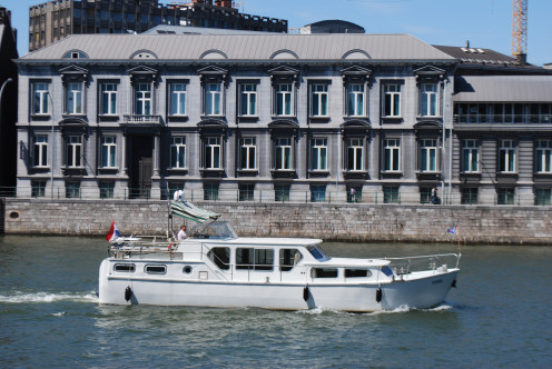View of a boat on the Meuse at Liège, in front of the former Chemistry Institute of Liège University, Roosevelt Quay, Liège