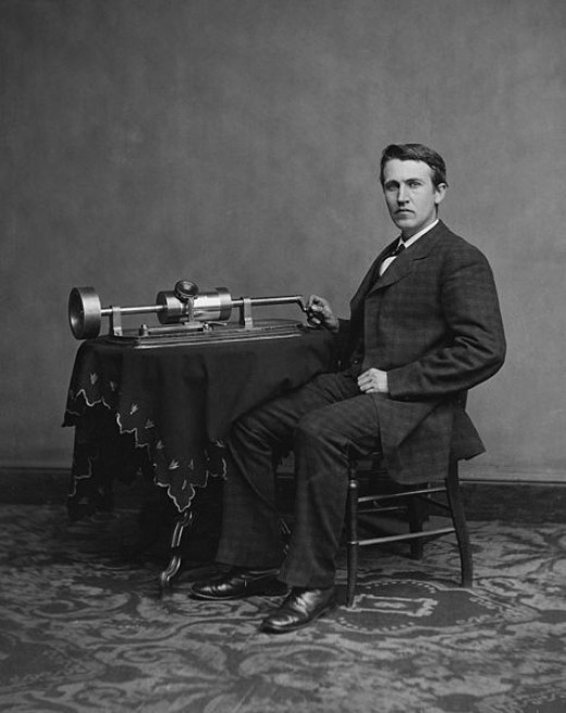 Thomas Edison with his invention, the phonograph.