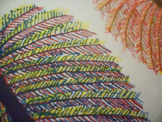 Close-up of feather design details.