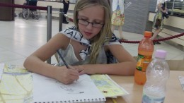 Still sketching images she saw in the Sistine Chapel as we had lunch in the museum cafeteria.