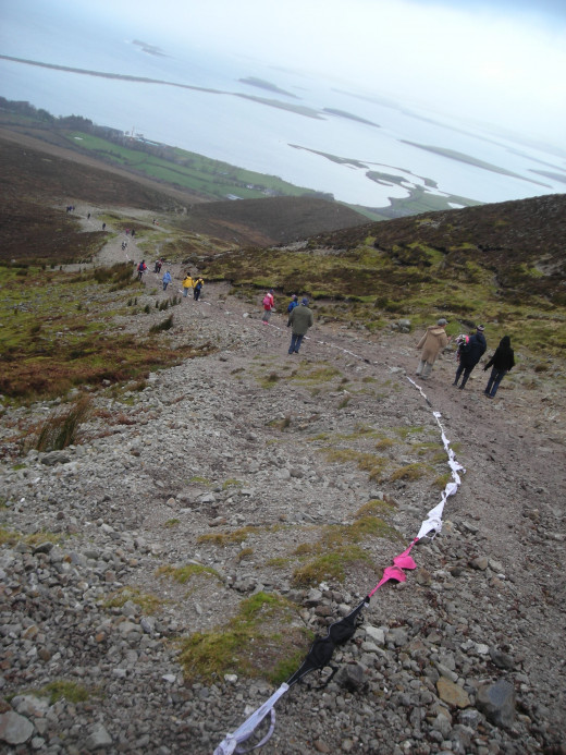 Croagh Patrick-Irelands Holy Mountain-Worlds longest bra chain record breaking attempt With beautiful view of Clew bay