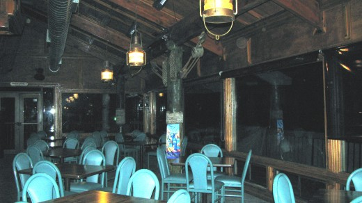 Orbs captured in the dining room.  There is one at the top far right and two at the top near the window.  The window wall to the right of the photograph is where I saw the sipirt dash by on the outside of the building.