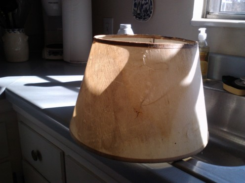 Stained and falling apart....this lamp shade needs replacing.