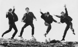 The Beatles lark about at a photo shoot.