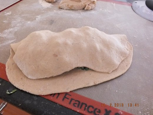 Crimp or roll the bottom layer of dough over the top.