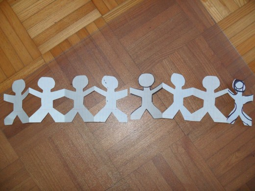 Learn how to make paper chain people