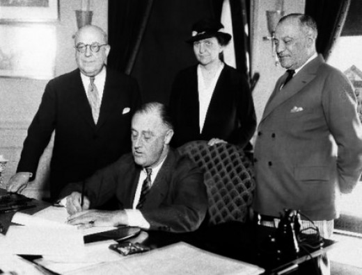 Roosevelt signs the Wagner Act: Secretary of Labor Frances Perkins in Background