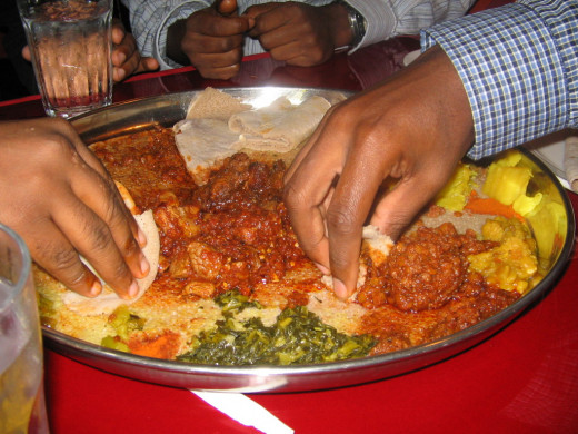 Ethiopian food is not only really tasty, it's fun. It's eaten by picking it up with a tangy, spongy bread called Injera.