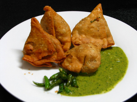 Samosas are a great introduction to Indian food - flaky pastry filled with a savory, spicy stuffing usually of potatoes and peas - delicious!