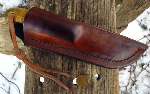 Hand stitched fold over sheath with fold over belt loop.