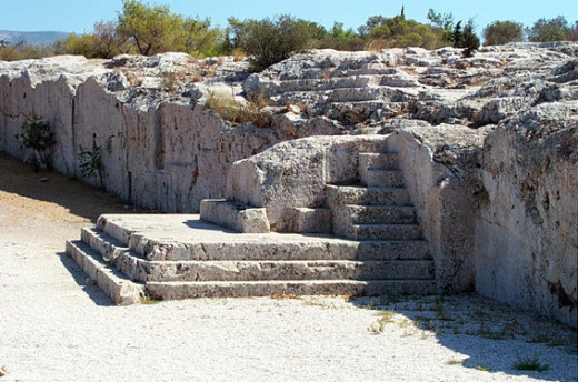 This is the Pnyx, a structure just west of the Acropolis where Athenian citizens normally assembled to decide law.