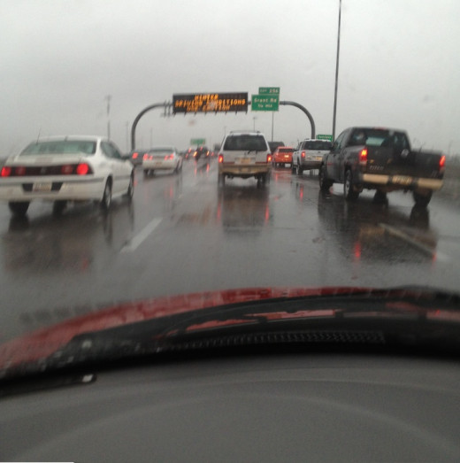 Traffic on Interstate-10 was slow with highway information sign warning of blizzard conditions.